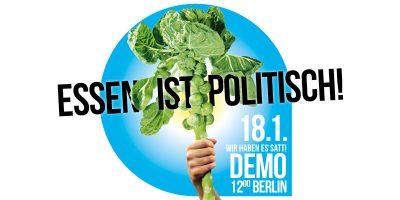 """""""Essen ist politisch"""": Demoaufruf zu """"Wir haben es satt"""" in Berlin. Bildmotiv ist eine Hand, die eine Stange Rosenkohl in die Höhe hält."""